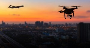 Silhouette,Of,Drone,Flying,Near,An,Airport,With,Airplane,,No